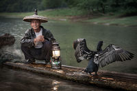 asia,boat,china,chinese,cormorant,fish,fisherman,fishing,guilin,hat,horizontal,household,lamp,lantern,li r