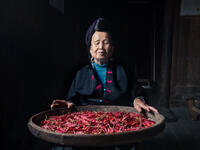 2017, asia, asian, china, chinese, da zhai, da zhai terrace fields, dazhai, elderly, environmental portait, female, indoor, indoors, longji, longji rice terraces, longsheng, male, man, old, older, peo
