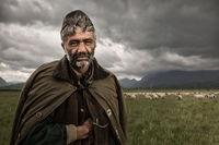 2016,environmental portait,europe,horizontal,landscape,male,man,people,portrait,romania,romanian,rural,sheep,shepherd,transilvania,transylvania