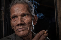 asia,asian,environmental portait,indonesia,indonesian,jakarta,java,male,man,old,portrait,rumpin,smoking,west java