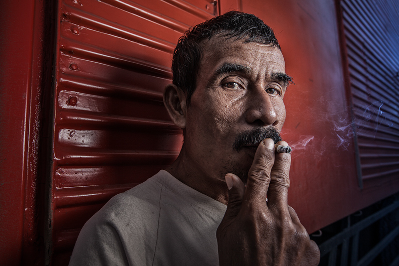 asia,asian,boat,dock,dock worker,environmental portait,indonesia,indonesian,jakarta,java,portrait,ship,smoking,sunda kelapa,west java