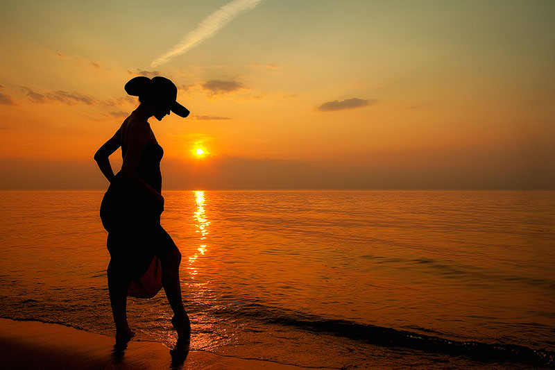 america,beach,dress,female,hat,horizontal,indiana,indiana dunes,lake michigan,midwest,north america,sand,silhouette,sunset,united states,us,usa,woman