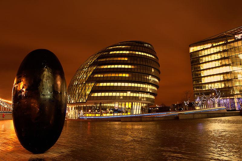 Balancing egg in London plaza near Tower Bridge