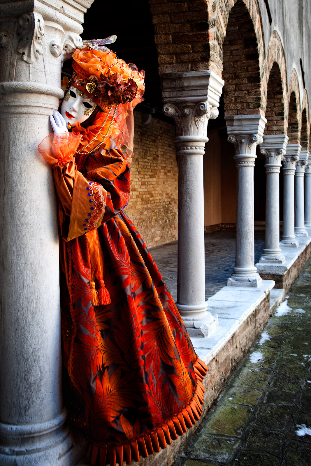 carnival, celebration, colorful, columns, costume, europe, italy, mask, orange, party, venice, vertical, photo