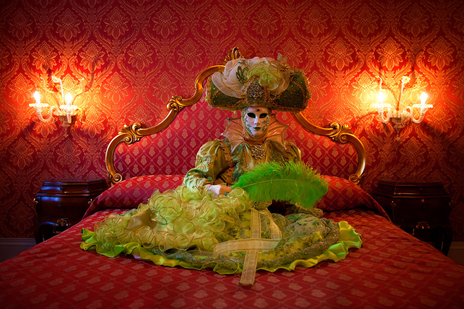 Venice Carnival model in a bed in her hotel room