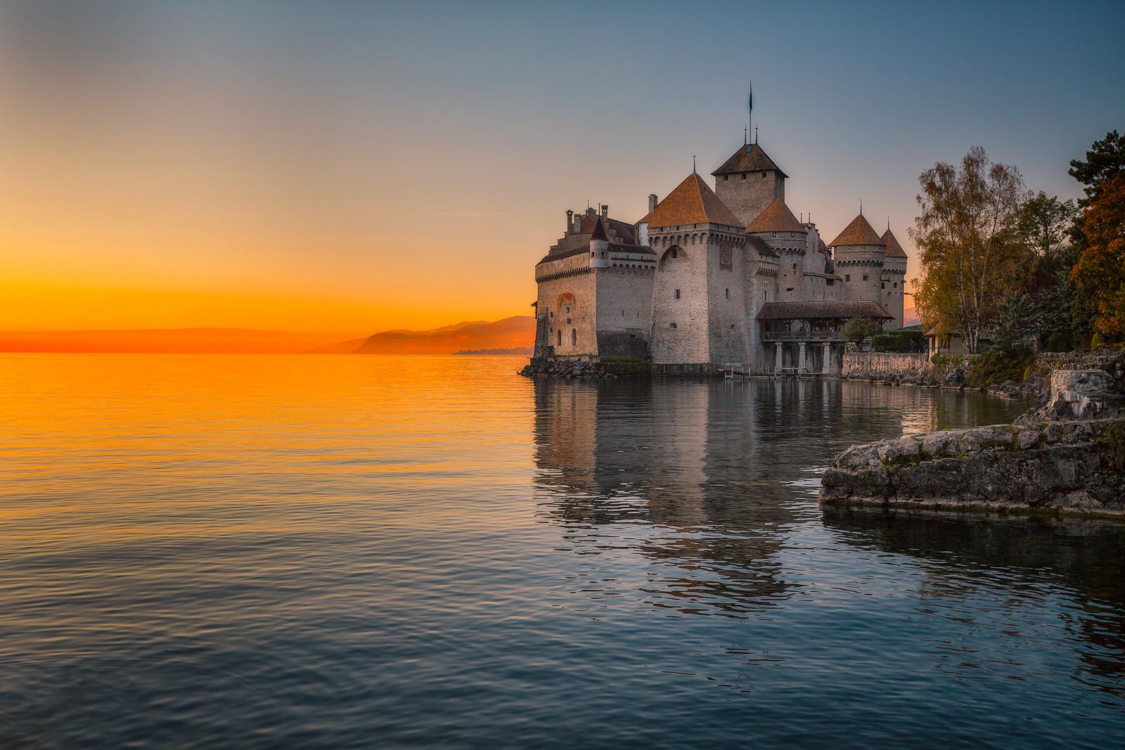 Cloudless sunset behind Switzerland's Chillon Castle