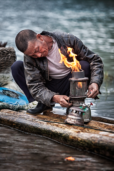 asia,china,chinese,cormorant,fish,fisherman,fishing,guilin,hat,household,lamp,lantern,li river,morning,portrait,vertical, photo