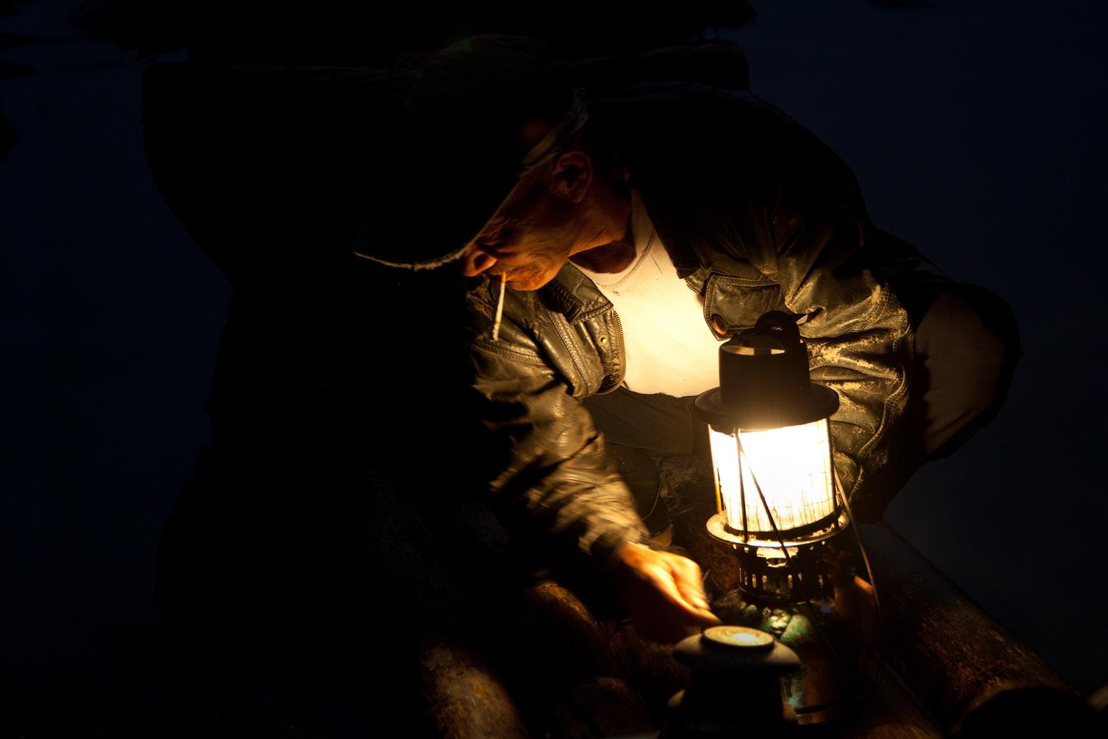 asia,china,chinese,cormorant,dark,fish,fisherman,fishing,guilin,holding,horizontal,household,lamp,lantern,li river,mor, photo