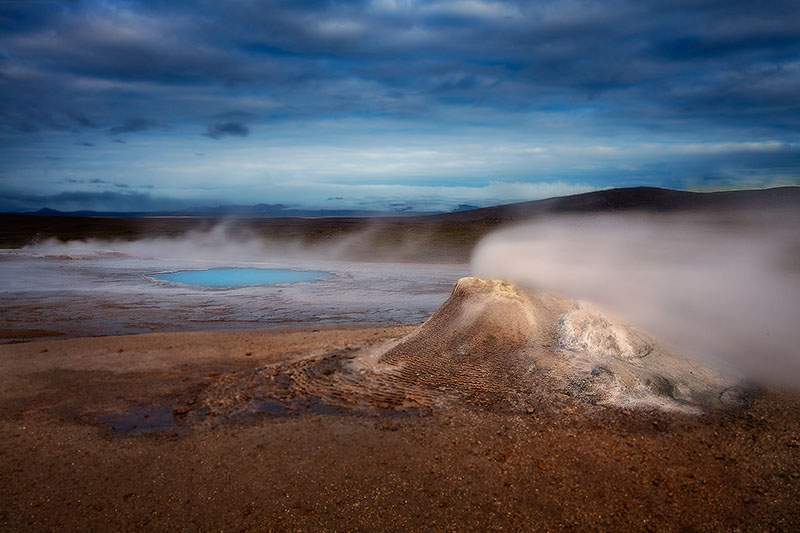 Active chimney and turqoise pool in a geothermal area of interior Iceland