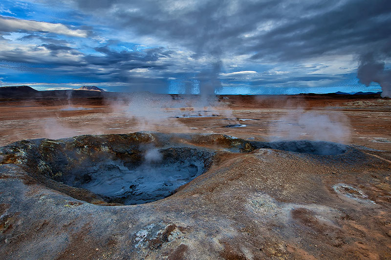 Boiling mud and sulfur pits in a geothermal area of Iceland
