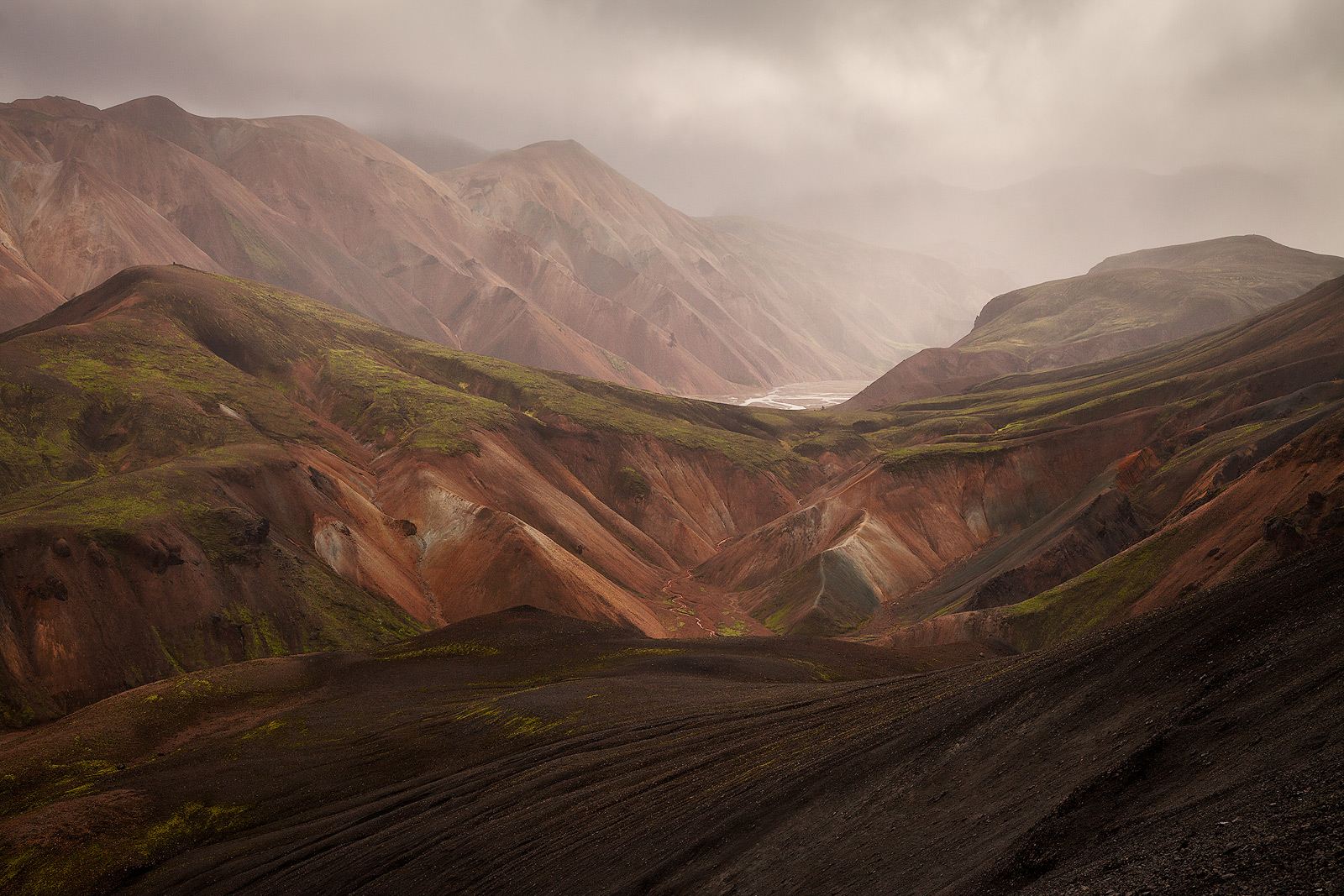 Clouds over sweeping volcanic landscape