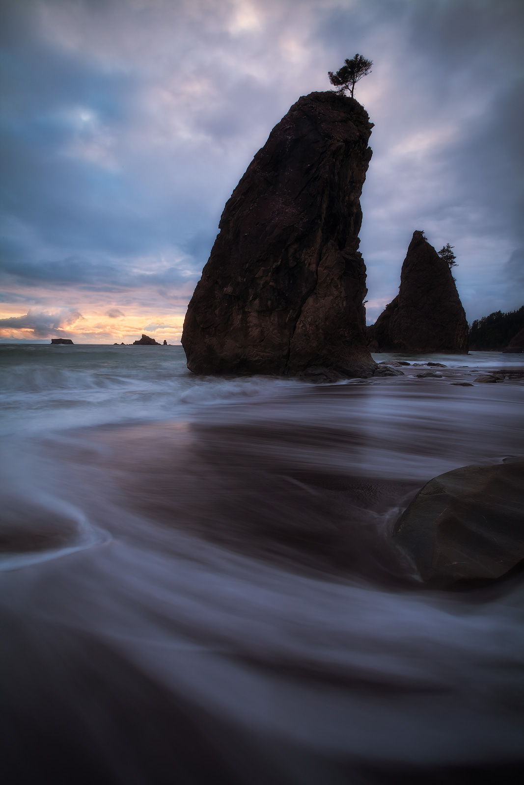 Retreating water in front of sea stacks on Washington's Rialto Beach