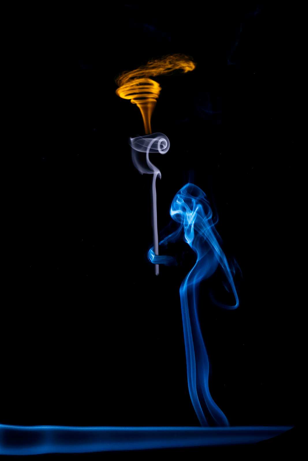 blue,composite,ghost,hooded,mysterious,scary,skeletal,skeleton,smoke,smoke picture,still,still life,torch,vertical, photo