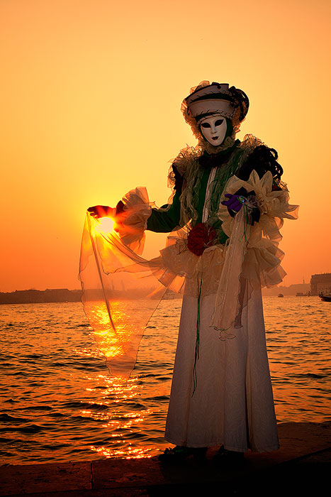 carnival, celebration, colorful, costume, europe, holding sun, italy, mask, party, san gorgio, sun, sunset, venice, vertical, photo