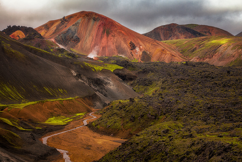 Valley and river cut through rugged volcanic landscape