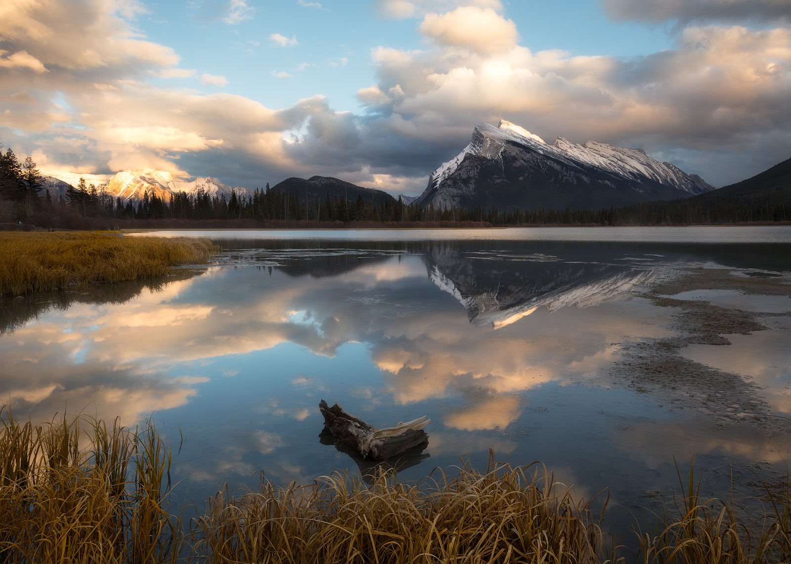 Mount Rundle reflecting in the still water of Vermillion Lakes on a quiet October evening.