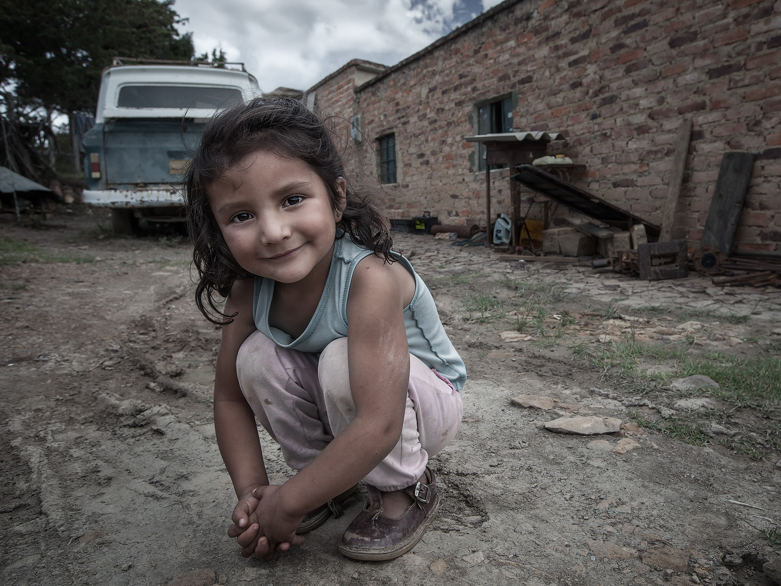 adorable,angelic,beautiful,boyaca,boyacá,colombia,colombian,colombiana,environmental portait,female,girl,happy,kneeling,portrait,south america,villa de leyva,boyacá, photo